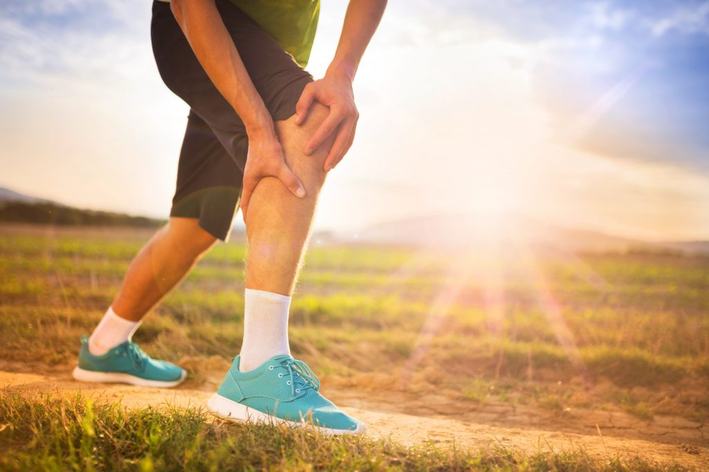 Runner suffering from calf pain after running-min